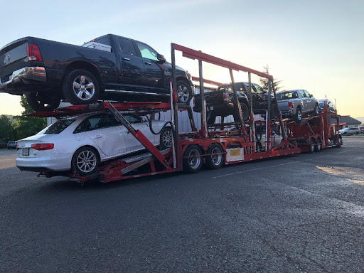7 Vehicles shipped on an open trailer